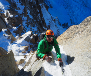 Superb Sunny Conditions On The Final Chimney Of The Cosmiques Arete